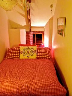 Cosy crog loft style bedroom with new bedding curtains for a warm inviting look!