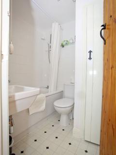 Bathroom, full size bath, electric shower, water heating controls