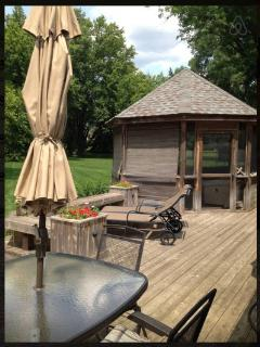 Back Yard, Deck, Gazebo, Table with Umbrella.