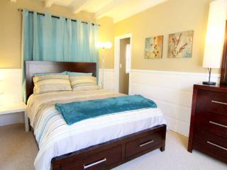 The bedroom, serene and tranquil to help you relax during your stay.