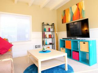 The living room, bright and inviting, complete with Wi-Fi and Apple TV!