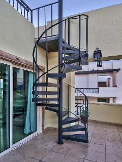 Spiral staircase leading to private rooftop terrace