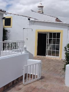 View from Patio to Garden Room &Terrace Bedroom above. We have the largest chimney in the area