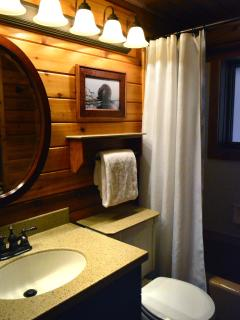 First bathroom, located between the 2 bedrooms, newly updated