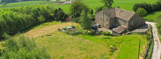 Tranquility! The Barn is surrounded by fields and woodland overlooking the Pennine hills
