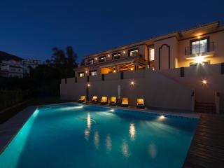 Rear of House and Pool at Night.