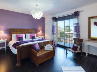 Master Bedroom with ensuite bathroom, balcony and walk in wardrobe