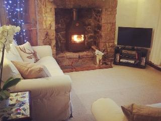 The Living Room boasts a log fire, smart Television with DVD player and the internet.