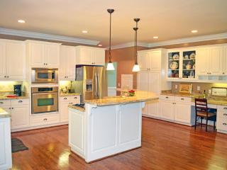 Chef's kitchen, beautiful granite, glass cooktop, double oven, all stainless appliances, work space+