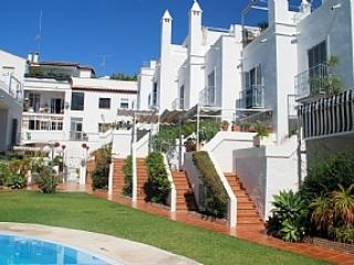 View towards the house from communal pool and gardesns