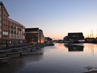 A view of the Docks at Dusk from the two juliet balconies and large windows of this Docks Apartment