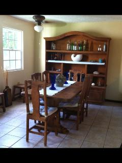 View of dining room, sits 6 and is next to an open kitchen