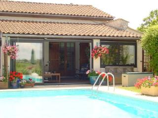 Your garden room/terrace opening upon the pool area