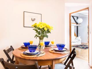 Fully equipped kitchen with big dining table.