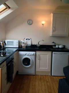 The Kitchen in The Barn: Induction Hob, Electric Fan Oven, Microwave, Fridge, Washing Machine