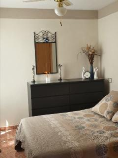 Double bedroom with double wardrobe space with ceiling fan with hairdryer
