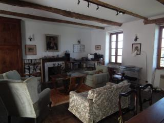 The living room with dining area for 8