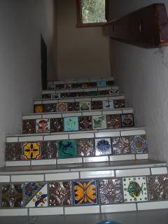 Hand-painted tiles from South America grace even the stairs!