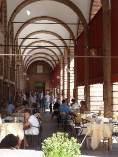 Colonnade in Amandola piazza with cafes and restaurants