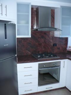 Cocina, cocina a gas y horno eléctrico