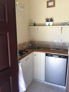 The fully equipped kitchenette with gas stove, fridge and freezer