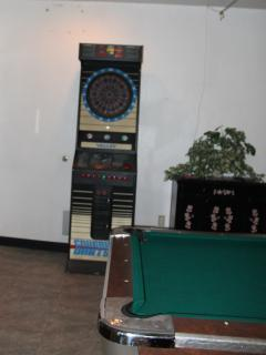 pool table and dart board in community room