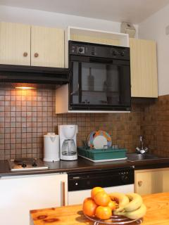 Kitchenette with fridge, oven, microwave, kettle, coffee maker, toaster etc.