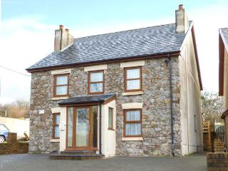 PEN-YR-ERW, detached holiday home, woodburner, WiFi, enclosed patio, external ga
