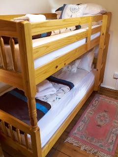 Bunk bed room with central heating radiator