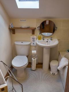 Bathroom with bath/shower, basin and WC