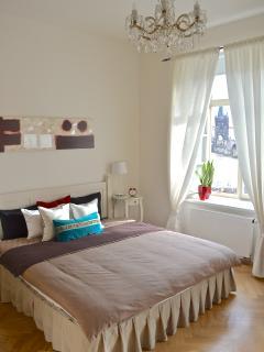 Master bedroom. Antique chandelier.
