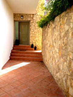 Secure entrance to the villa with electronic gates and entry phone system.