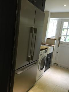 The scullery with butler's sink, huge fridge/freezer and washer/dryer, leads off the kitchen