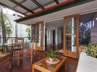 Open plan spaces for relaxing. Deck overlooks fenced yard and parkland.