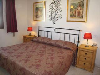 double bedroom with in built-in wardrobes and ceiling fan