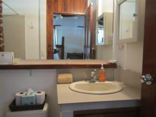 A large mirror at the sink area.