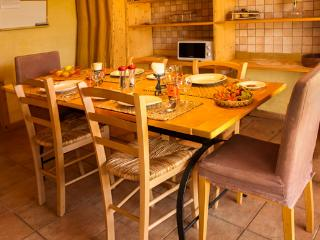 Fully equipped kitchen with stove, oven, fridge, microwave and seating for 8.