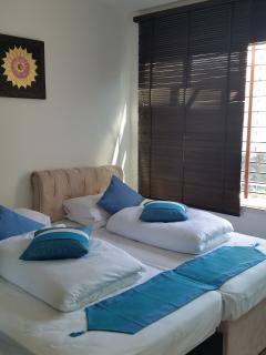 Bedroom 2 has 2 large and comfortable single beds