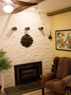 A lovely gas fireplace to cozy up in front of in the evenings