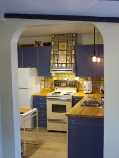 Inviting kitchen with original tile work