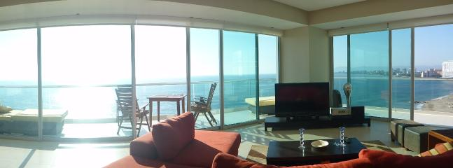 Living room panorama. Floor to ceiling glass.