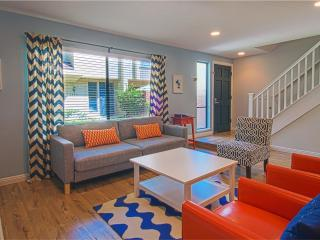 Leather recliners and queen size sofa bed. Cool decor and fun colors. What's not to love?