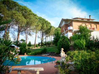Impressive villa situated in vast green park, boasts lovely grounds, private pool and terrace, sleeps 8, Fauglia