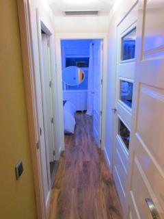 SECOND CORRIDOR LEADING TO AHEAD BEDROOM 2 AND ON LEFT BATHROOM