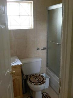 Clean and functional bathroom, glass shower screen, and HOT water
