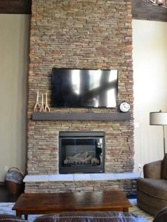 Stacked stone gas fireplace in main living room