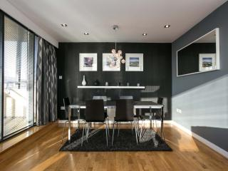 Dining area for 6 people beside full length windows overlooking amazing views of Belfast