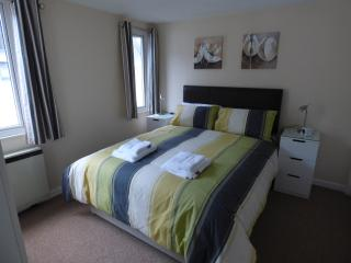 Main bedroom with King Size bed,  bedside tables and lamps