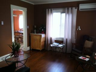 Living room with a peek of the kitchen, showing the refinished original fir floors