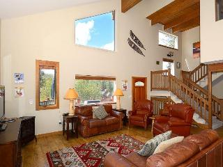 Vaulted ceilings and large windows spill light into the home
